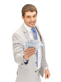 Handsome man with euro cash money Stock Images