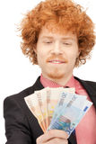 Handsome man with euro cash money Stock Photo