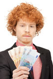 Handsome man with euro cash money Royalty Free Stock Image