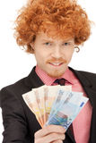 Handsome man with euro cash money Stock Image