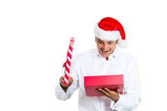 Handsome man excited about his christmas present Stock Image