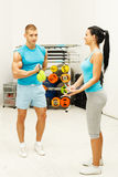 Handsome man exercises with kettle bell Royalty Free Stock Images