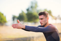 Handsome man exercising in forest Royalty Free Stock Images