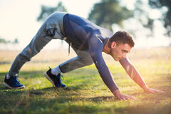 Handsome man exercising in forest Royalty Free Stock Photos
