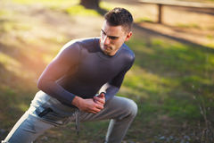 Handsome man exercising in forest Stock Image