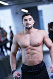 Handsome man exercising at the gym Royalty Free Stock Image