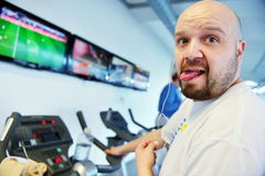 Handsome man exercising at the gym Stock Image