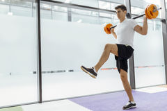 Handsome man exercising and lifting weights Royalty Free Stock Photography