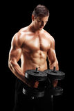 Handsome man exercising with two weights Stock Image