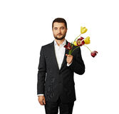 Handsome man with faded flowers Stock Photos