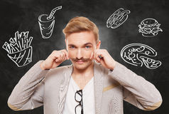 Handsome man and fast food temptation Stock Photography