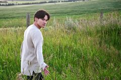 Handsome man in a field Royalty Free Stock Photos