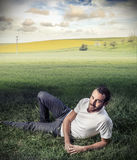 Handsome man in the fields Stock Image