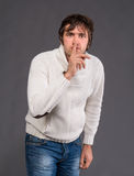 Handsome man with finger on lips asking for silence Royalty Free Stock Image