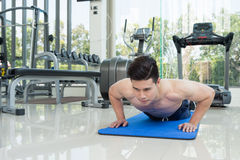 Handsome man fitness exercising by doing push ups as part of bod Royalty Free Stock Images