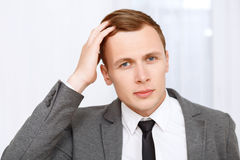 Handsome man fixing his hair Royalty Free Stock Image