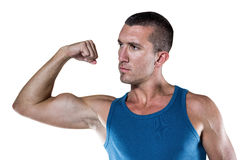 Handsome man flexing muscles Royalty Free Stock Images