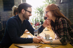 Handsome man flirting with cute woman in restaurant Royalty Free Stock Image
