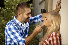 Handsome man flirting with young woman outdoors Stock Image
