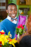 Handsome Man in Flower Shop Buys Roses Stock Images