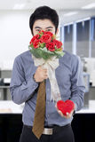 Handsome Man with Flowers and A Gift Stock Photos