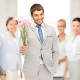 Handsome man with flowers in hand Stock Photo