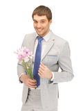 Handsome man with flowers in hand Royalty Free Stock Image