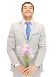 Handsome man with flowers in hand Royalty Free Stock Images