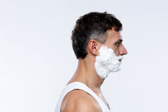Handsome man with foam on face Royalty Free Stock Photos