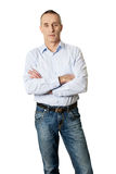 Handsome man with folded arms. Confident handsome mature man with folded arms Royalty Free Stock Images