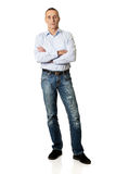 Handsome man with folded arms. Confident handsome mature man with folded arms Stock Photo