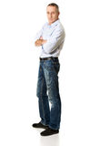 Handsome man with folded arms. Confident mature man with folded arms Stock Image