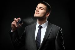 Handsome man in formal suit and with bottle royalty free stock image
