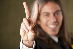 Handsome man in formalwear making a peace sign Stock Images