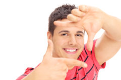 Handsome man framing photo with his hands Stock Photography