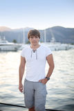 Handsome man in front of sunset and luxury yacht background on t Royalty Free Stock Photos
