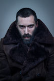 Handsome man in fur coat Stock Photography