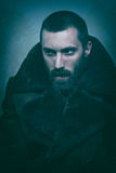 Handsome man in fur coat. Retro style Stock Photography