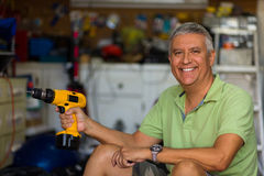Handsome man in garage Stock Images