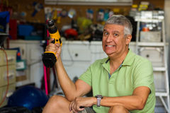 Handsome man in garage Royalty Free Stock Photography