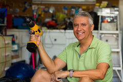 Handsome man in garage Royalty Free Stock Photo