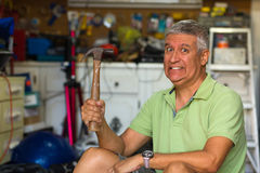 Handsome man in garage Stock Photography