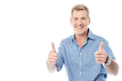 Handsome man gesturing double thumbs up Royalty Free Stock Images