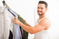 Handsome man getting dressed at home Royalty Free Stock Photo