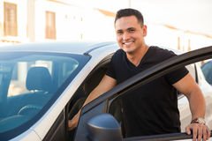 Handsome man getting into his car Stock Images