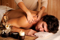 Handsome man getting massage Royalty Free Stock Images