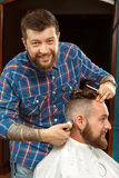 Handsome man getting new haircut in a barber shop Royalty Free Stock Photography