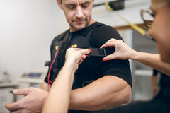Handsome man getting prepared for ems training Royalty Free Stock Images