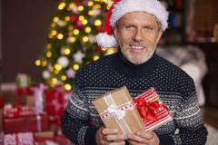 Handsome man with gift boxes. Handsome man holding some gift boxes Royalty Free Stock Images