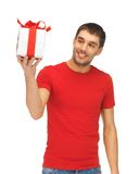 Handsome man with a gift. Bright picture of handsome man with a gift Royalty Free Stock Photography